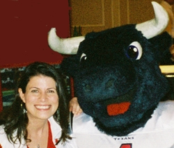 Picture of Stephanie Stradley and the Houston Texans mascot, Toro.